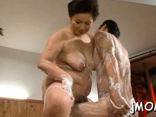 Expansive titted asian elder gets screwed hard in doggy position