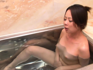 Naughty Asian girl fingers the brush pussy in the bathtub
